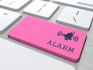 Security Concept - The Red Alarm Button on Modern Computer Keyboard. 3D Render.