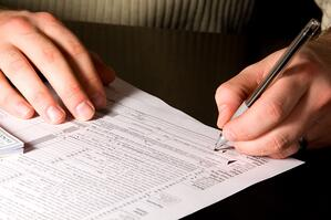 person signing tax form-1