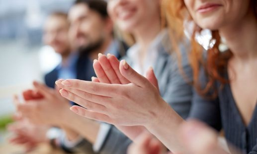 people clapping at professional association meeting